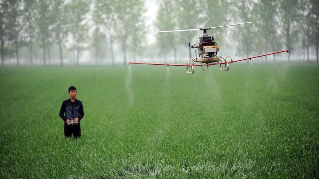 Commercial agriculture drone spraying fertilizer